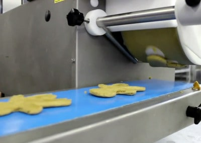 Formatic Cookie Machine Depositing Gingerbread Men